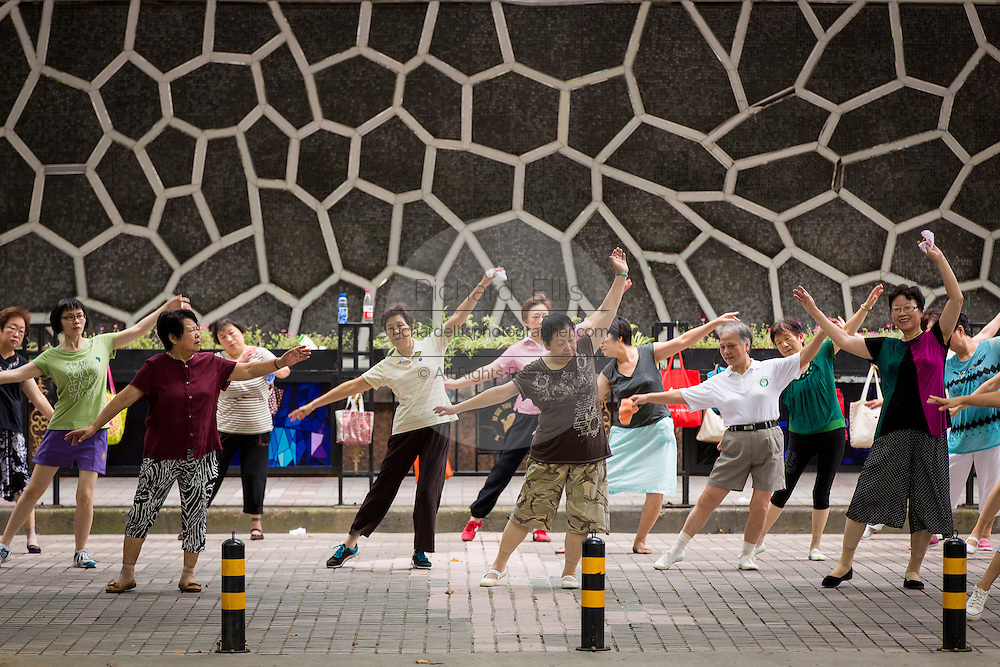 Elderly woman practice dance exercises in Fuxing Park Shanghai, China
