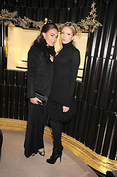 Left to right, sisters TAMARA ECCLESTONE and PETRA ECCLESTONE at a party to celebrate the launch of a collection of jewellery by Tamara Ecclestoen for jewellers Moussaieff held at their store in New Bond Street, London on 9th December 2008.
