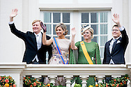 15-9-2015 THE HAGUE - Prince Constantijn and Princess Laurentien waving King Willem-Alexander and Queen Maxima from Noordeinde Palace on Budget Day 2015. Every third Tuesday of September is Budget Day, the festive opening of the new parliamentary year of the States General (the Senate and House). His Majesty the King on Budget Day rides in the Golden Carriage to the Binnenhof in The Hague speaks during the joint session of the States General in the Knights from the throne speech. COPYRIGHT ROBIN UTRECHT<br /> prinsjesdag , koningin , koning , gouden koets , troonrede , binnenhof , paarden , politiek ,