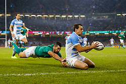 Argentina Winger Juan Imhoff gathers to score the second try of the game as Ireland Full Back Rob Kearney tackles - Mandatory byline: Rogan Thomson/JMP - 07966 386802 - 18/10/2015 - RUGBY UNION - Millennium Stadium - Cardiff, Wales - Ireland v Argentina - Rugby World Cup 2015 Quarter Finals.
