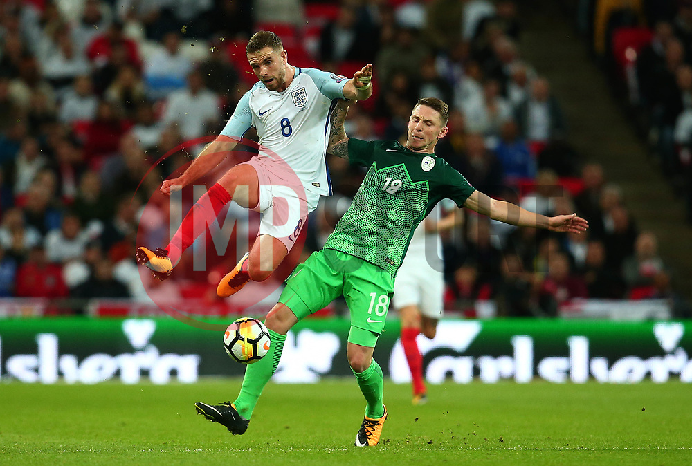 Jordan Henderson of England beats Rajko Rotman of Slovenia to the ball - Mandatory by-line: Robbie Stephenson/JMP - 05/10/2017 - FOOTBALL - Wembley Stadium - London, United Kingdom - England v Slovenia - World Cup qualifier