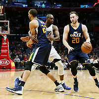 25 March 2016: Utah Jazz forward Gordon Hayward (20) drives past LA Clippers forward Luc Mbah a Moute (12) on a screen set by Utah Jazz center Rudy Gobert (27) during the Los Angeles Clippers 108-95 victory over the Utah Jazz, at the Staples Center, Los Angeles, California, USA.