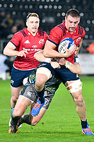 Rugby Union - 2019 / 2020 Champions Cup: Ospreys vs. Munster<br /> <br /> Tommy O'Donnell of Munster attacks, at The Liberty Stadium.<br /> <br /> COLORSPORT/WINSTON BYNORTH