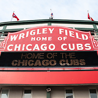 Photo of Wrigley Field sign. Wrigley Field is home of the Chicago Cubs and was built in 1914 making it one of the oldest baseball stadiums in the United States.
