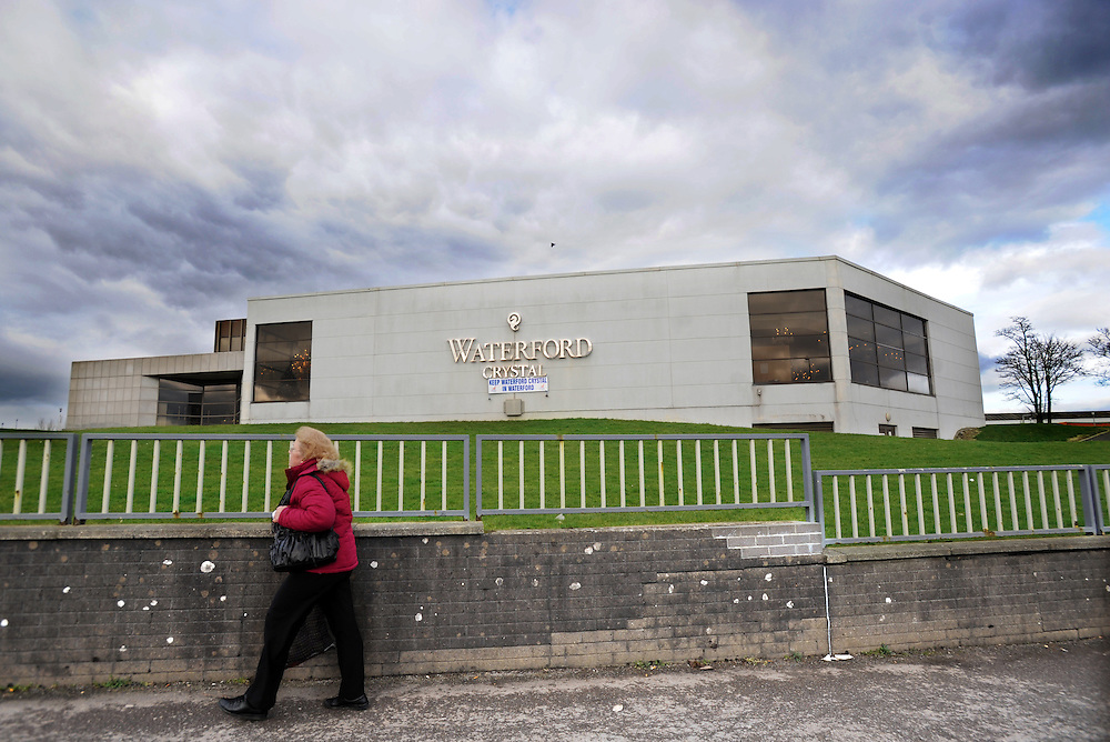 A woman walks past the Waterford crystal factory in Waterford, Ireland. Workers have been occupying the factory in protest for two weeks since the company went into receivership. Production is to move to lower cost countries. Crystal manufacturing began in Waterford in 1783. 13/2/2009