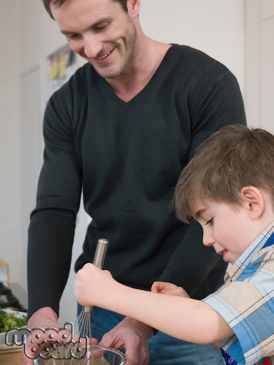 Son Helping Father in Kitchen