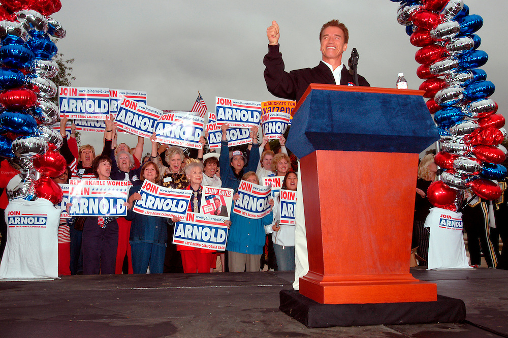 """Arcadia, CA, USA, Oct. 10th 2003: Arnold Schwarzenegger continued his """"California Comeback Express"""" campaign tour troughout California in his attemt to perusade the californians to vote for recall of Gray Davis and elect the actor as the new Governor of California.<br /> <br /> <br /> <br /> At the Los Angeles Arboretum in Arcadia, Arnold greeting supporteres.<br /> <br /> <br /> <br />  *** Local Caption *** , posted on Corbis web ,"""