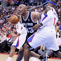 16 December 2013: San Antonio Spurs power forward Boris Diaw (33) drives past Los Angeles Clippers small forward Stephen Jackson (1) during the Los Angeles Clippers 115-92 victory over the San Antonio Spurs at the Staples Center, Los Angeles, California, USA.