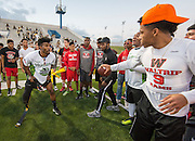 Members of the Waltrip High School football team test their skills against players on the Wounded Warrior Amputee Football Team before a game against NFL Alumni, at Delmar Stadium, February 1, 2017.