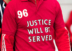 """SUNDERLAND, ENGLAND - Saturday, September 15, 2012: A Sunderland fan with a """"Justice will be served"""" t-shirt before the Premiership match between Sunderland and Liverpool at the Stadium of Light. (Pic by Vegard Grott/Propaganda)"""