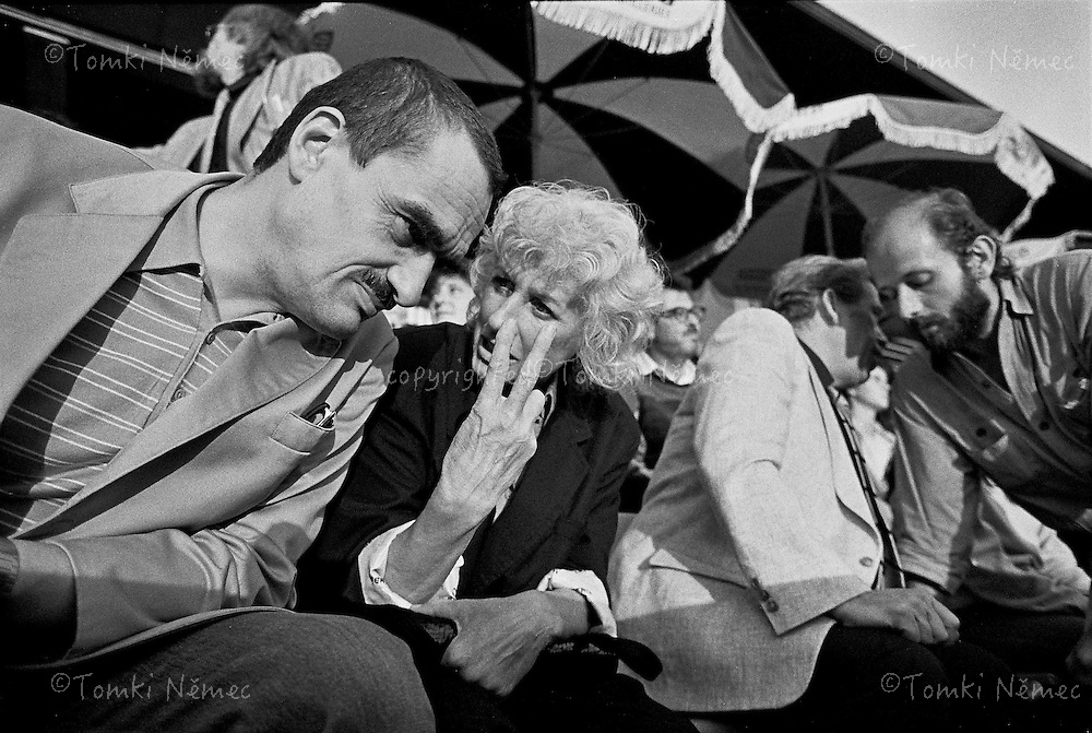 Olga Havel - first wife of Vaclav Havel speaking with Karel  Schwarzenberg on the concert of the Rolling Stones in Prague, Czechoslovakia, 1990. Vaclav havel speaking with his friend from jail ( on the right side).