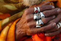 "India, Nasik, 2006. Morning's soft light reflects off the rings of a ""sadhu'"" or traveling holy man, on the banks of the Godavari River. Winner of National Geographic Traveler's First Prize."