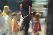a children daycare taker walking with kids