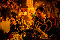 Waving a lantern of frankincense, The procession of the Brotherhood (Hermandad) San Benito, Holy Week (Semana Santa), Seville, Andalusia, Spain.