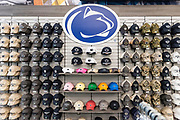 Souvenir hats displayed in the Penn State bookstore