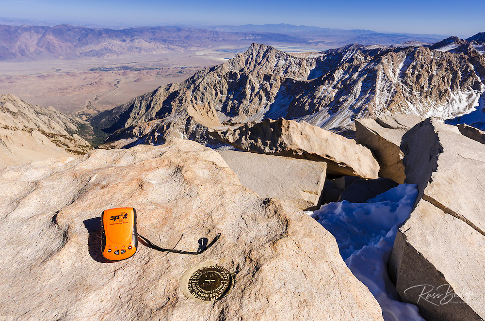 SPOT messenger and USGS marker on the summit of Mount Whitney, Sequoia National Park, California USA