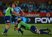 PRETORIA, South Africa, 18 MAY 2013 : Arno Botha of the Bulls powering forward with Tamati Ellison (left) and Chris King of the Highlanders making the tackle during the SupeRugby match between the BULLS and the HIGHLANDERS at Loftus Versfeld in Pretoria, South Africa on 18 MAY 2013. Bulls 35 - 18 Highlanders.<br /> <br /> © Anton de Villiers / SASPA