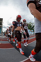 KELOWNA, BC - AUGUST 17:  Cole STREGGER #19 and Liam JOHNSTONE #40 of Okanagan Sun walk to the field against the Westshore Rebels at the Apple Bowl on August 17, 2019 in Kelowna, Canada. (Photo by Marissa Baecker/Shoot the Breeze)