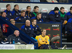 WEST BROMWICH, ENGLAND - Sunday, January 1, 2011: Everton's captain Phil Neville storms off to sit on the floor after finding no seats for him on the bench after being substituted against West Bromwich Albion during the Premiership match at the Hawthorns. (Pic by David Rawcliffe/Propaganda)