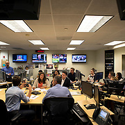 "August 29, 2014 - New York, NY : ABC News Anchor David Muir (foreground left) takes part in an editorial meeting with producers at the ""World News Tonight with David Muir"" rim  in the ABC News building on West 66th Street on Friday afternoon. David Muir is taking over for Diane Sawyer as anchor of ABC's ""World News Tonight."" CREDIT: Karsten Moran for The New York Times"