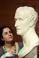 Adeline member of Scottish Gallery of Scotland press office holding sculpture Antonio Canova (1757-1822).<br /> Scottish Gallery of Scotland display a new exhibition called Head to Head. Portrait Sculpture  from 6th June 2014 to 10 January 2016.<br /> <br /> Pic by Pako Mera