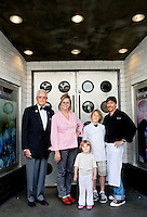 L-R: Foreign Cinema chef and owners, Gayle Pirie, and her husband, John Clark, far right, with their children, Magnus, 10, and Pearl, 3, and Gayle's father, Greig Pirie, far left, at the entrance of their restaurant, on Friday, June 12, 2009..