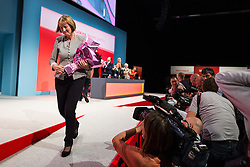 © Licensed to London News Pictures . 27/09/2015 . Brighton , UK . HARRIET HARMAN steps off stage following a tribute to her record as Deputy Leader of the Labour Party , at the 2015 Labour Party Conference . Photo credit : Joel Goodman/LNP