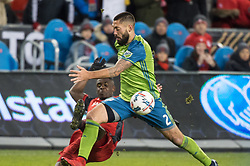 December 9, 2017 - Toronto, Ontario, Canada - Seattle Sounders midfielder CLINT DEMPSEY (2) collides with Toronto FC defender CHRIS MAVINGA (23) during the MLS Cup championship match at BMO Field in Toronto, Canada.  Toronto FC defeats Seattle Sounders 2 to 0. (Credit Image: © Mark Smith via ZUMA Wire)