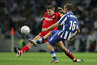 Photo: Paul Thomas.<br /> Porto v Liverpool. UEFA Champions League Group A. 18/09/2007.<br /> <br /> Steven Gerrard (L) of Liverpool goes for the ball from Raul Meireles.