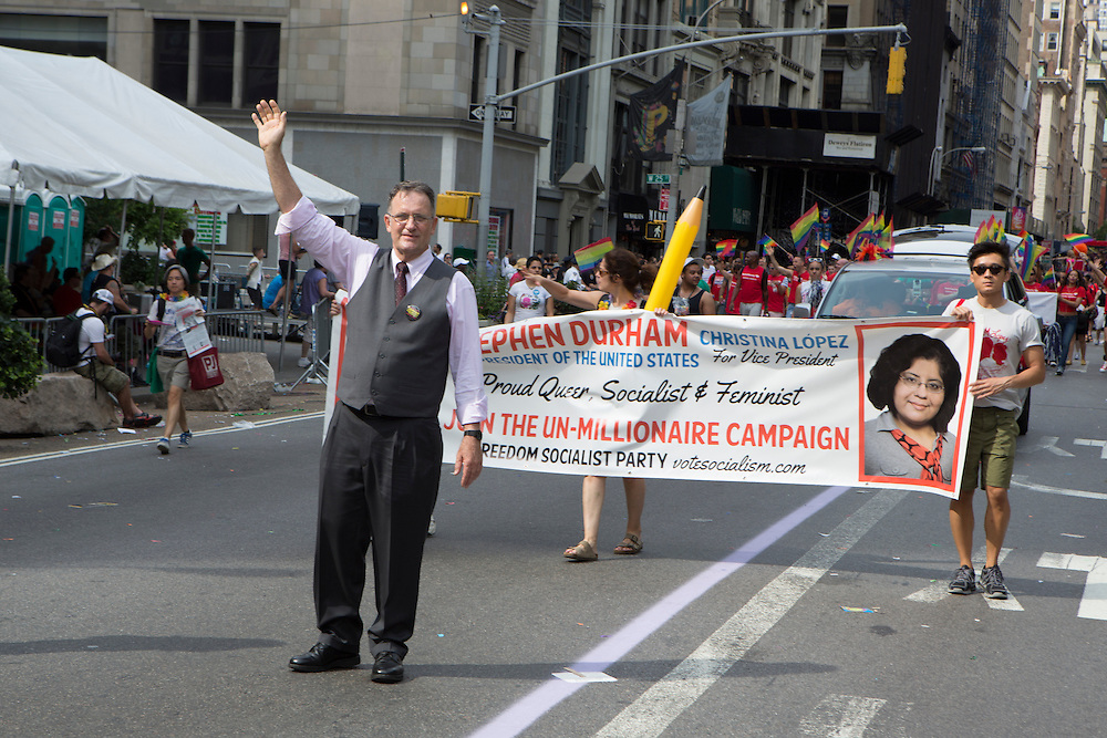 "Stephen Durham, the Freedom Socialist Party candidate for president in 2012, marches with his supporters. Durham is gay, and refers to his campaign as ""the un-millionaire campaign."""