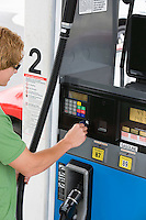 Man operating fuel pump payment kiosk