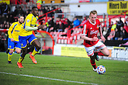 Mark Beck of Wrexham on loan from Yeovil Town sprints away from Tyrone Williams during the Vanarama National League match between Wrexham AFC and Kidderminster Harriers at the Glyndŵr University Racecourse Stadium, Wrexham, United Kingdom on 23 February 2016. Photo by Mike Sheridan.
