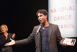 © Licensed to London News Pictures. 26/01/2015. London, England. Cuban-born dancer Carlos Acosta wins the De Valois Award for Outstanding Achievement - with Darcey Bussell at the back. The Critic's Circle National Dance Awards 2014 take place at The Place in London, UK. Photo credit: Bettina Strenske/LNP