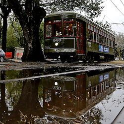 Jan 30, 2013; New Orleans, LA, USA; A street car is reflected in a puddle as it passes on the historic St. Charles Avenue street car line. Super Bowl XLVII will be played between the San Francisco 49ers and the Baltimore Ravens on February 3, 2013 at the Mercedes-Benz Superdome. Mandatory Credit: Derick E. Hingle-USA TODAY Sports