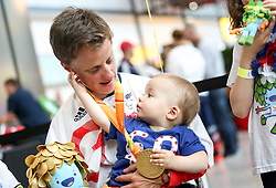 © Licensed to London News Pictures. 20/09/2016. London, UK. Team GB Paralympian EMMA WIGGS with son Noah at terminal 5 of London Heathrow Airport after flying on British Airways flight BA2016. Wiggs won gold in KL2 classification of paracanoe. Team GB finished second in the Paralympics medals table with 147 medals beating their total of 120 at London 2012. Photo credit : Tom Nicholson/LNP