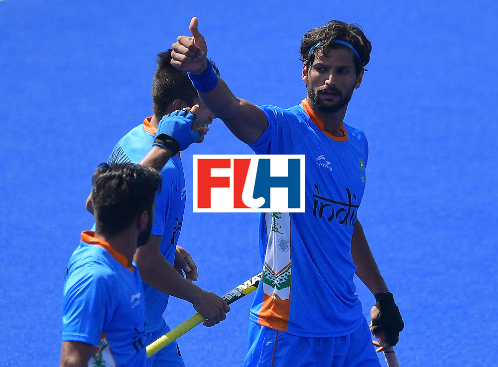 India's Rupinder Pal Singh (R) celebrates scoring a goal during the men's field hockey India vs Ireland match of the Rio 2016 Olympics Games at the Olympic Hockey Centre in Rio de Janeiro on August, 6 2016. / AFP / Carl DE SOUZA        (Photo credit should read CARL DE SOUZA/AFP/Getty Images)