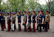 Young Russian Don Cossacks have their uniforms inspected before marching in a parade at the Don Cossack Military School in Novocherkassk, Russia.
