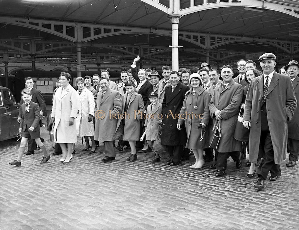 12/03/1961<br /> 03/12/1961<br /> 12 March 1961<br /> F.A.I. Cup 2nd round: Shamrock Rovers v Waterford at Glenmalure Park, Milltown, Dublin. Some of the fans up for the match at the train station.