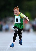 20 Aug 2016: Ciaran McAreavey, from Meath, crosses the line in the Boys U10 100m heats.   2016 Community Games National Festival 2016.  Athlone Institute of Technology, Athlone, Co. Westmeath. Picture: Caroline Quinn