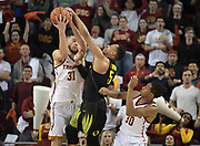 Feb 15, 2018; Los Angeles, CA, USA; Oregon Ducks guard Elijah Brown (5) battles for the ball with Southern California Trojans guard Elijah Stewart (30) and forward Nick Rakocevic (31) during an NCAA basketball game at Galen Center. USC defeated Oregon 72-70.
