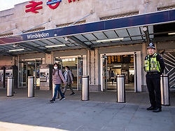 © Licensed to London News Pictures. 18/05/2020. London, UK. Police patrol Wimbledon Station in South West London as more trains are put in to service to get commuters to work while following social distancing guidelines. Government has urged people to go to work if they cannot work from home as Mayor of London Sadiq Khan restarts the congestion zone while upping the price and making it 7 days a week.  Photo credit: Alex Lentati/LNP