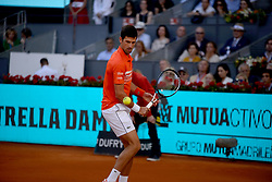 May 12, 2019 - Madrid, Spain - Novak Đoković of Croatia plays in the final match against  Stefanos Tsitsipas of Greece in the Mutua Madrid Open at La Caja Magica in Madrid on 12nd May, 2019. (Credit Image: © Juan Carlos Lucas/NurPhoto via ZUMA Press)