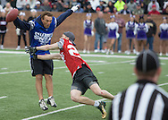 Former NFL Superstar, Doug Flutie jukes the tag and shows he is still elusive during the Celebrity Flag Football match, Super Bowl 51 - 16th Annual Celebrity Flag Football Challenge, Rhodes Stadium,  4 Feb 2017, Katy TX.   Red Team Captain Kirk Cousins would lose for the 2nd straight year to Doug Flutie's Blue team by a final score of 40-35.