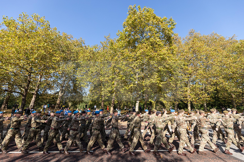 """© Licensed to London News Pictures. 10/10/2018. London, UK. 120 army personnel march down Birdcage Walk, led by the Band of the Grenadier Guards, to a """"welcome home"""" reception in the Palace of Westminster, to highlight the breadth of the British Army's current activities. Photo credit : Tom Nicholson/LNP"""