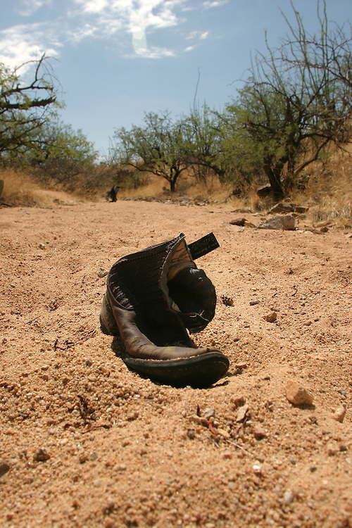 Shoes are left behind in the desert by an undocumented immigrant near the town of Arvaka, AZ on Thursday July 13, 2006.....