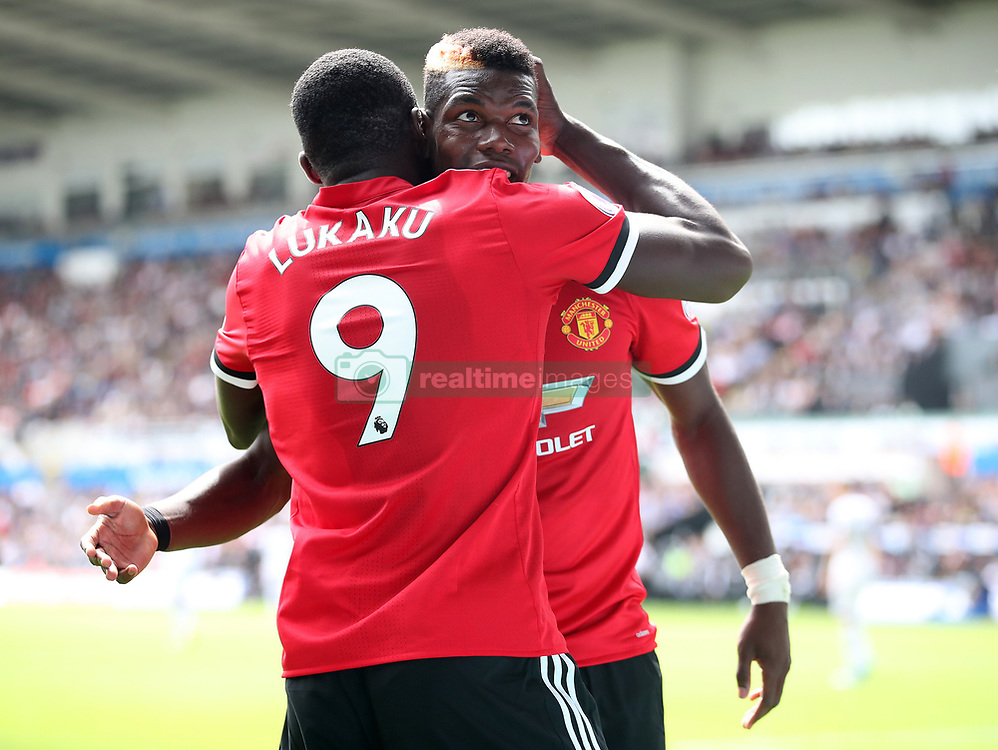 Manchester United's Paul Pogba (right) celebrates scoring his side's third goal with team-mate Romelu Lukaku during the Premier League match at the Liberty Stadium, Swansea.