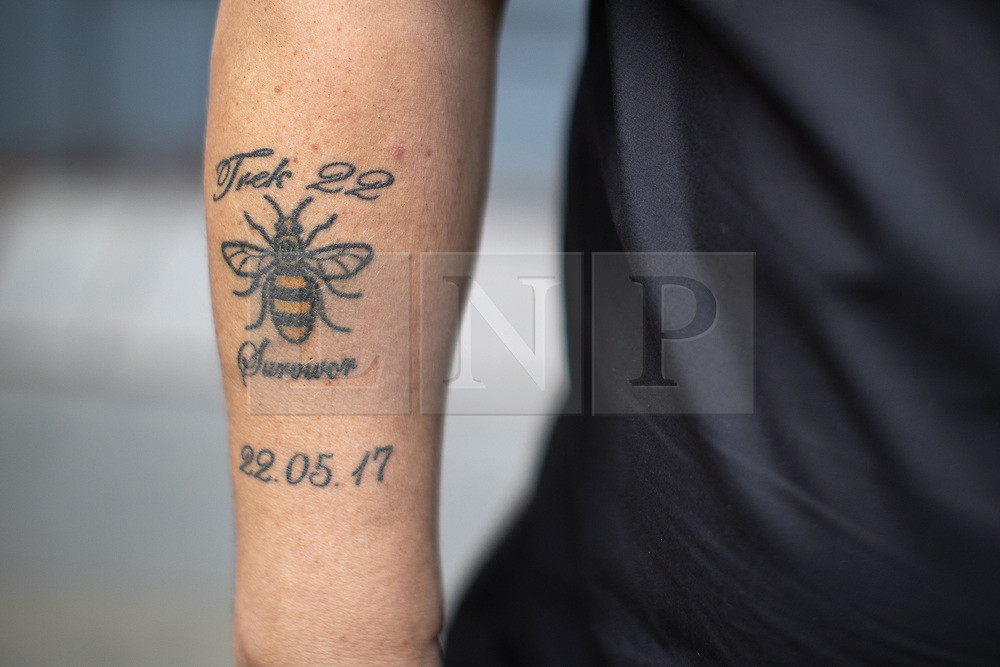 © Licensed to London News Pictures . 22/05/2019. Manchester, UK . Survivor and father ANDY WHOLEY , who was waiting to collect his daughter in the foyer of Manchester Arena when the bomb was triggered . People in St Ann's Square in Manchester City Centre on the second anniversary of the Manchester Arena bombing following a private service in St Ann's Church . On the evening of 22nd May 2017 , Salman Abedi murdered 22 people and seriously injured dozens more , when he exploded a bomb in the foyer of the Manchester Arena as concert-goers were leaving an Ariana Grande gig . Photo credit: Joel Goodman/LNP