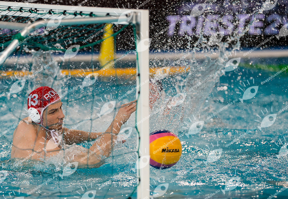 13 Marius TIC (GK-red cap)  ROU<br /> FINA Men's Water polo Olympic Games Qualifications Tournament 2016<br /> Final 7th place<br /> Germany GER (White) Vs Roumania ROU (Blue)<br /> Trieste, Italy - Swimming Pool Bruno Bianchi<br /> Day 08  10-04-2016<br /> Photo  L.Binda/Insidefoto/Deepbluemedia