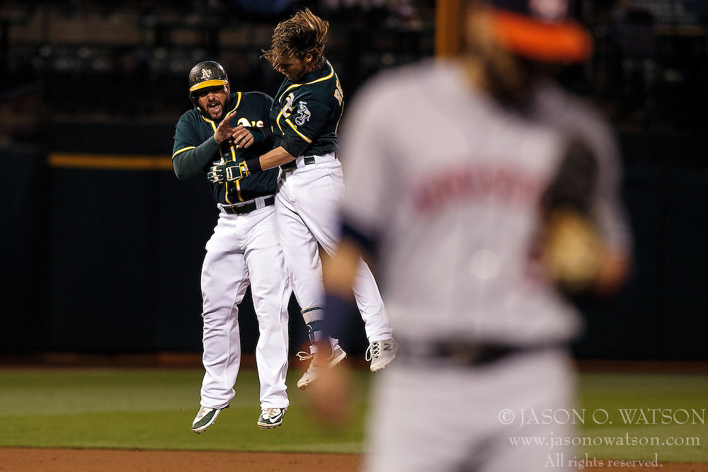 OAKLAND, CA - JULY 19:  Josh Reddick #22 of the Oakland Athletics is congratulated by Yonder Alonso #17 after hitting a walk off single against the Houston Astros at the Oakland Coliseum on July 19, 2016 in Oakland, California. The Oakland Athletics defeated the Houston Astros 4-3 in 10 innings.  (Photo by Jason O. Watson/Getty Images) *** Local Caption *** Josh Reddick; Yonder Alonso