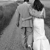 The bride and groom go for a walk down a country lane somewhere near the Costa Brava, Catalonia, Spain.